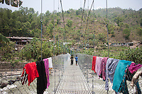 Nepalese children walk on a bridge at Shila Porbot, outskirts of Kathmandu, Nepal. May 8, 2015