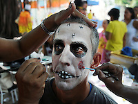 """A patient from mental health hospital Nise da Silveira has his face painted for the institute's carnival parade for participate at """"Loucura Suburbana,""""  (Suburban Madness) carnival group, Rio de Janeiro, Brazil, February 12, 2015. Patients, their relatives and workers from the institute held their parade one day before the official start of Carnival.."""