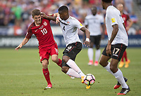 Commerce City, CO - Thursday June 08, 2017: Christian Pulisic, Sheldon Bateau during a 2018 FIFA World Cup Qualifying Final Round match between the men's national teams of the United States (USA) and Trinidad and Tobago (TRI) at Dick's Sporting Goods Park.