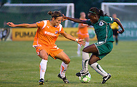 Saint Louis Athletica forward Enoila Aluko (9) handles the ball in front of Sky Blue FC defender/midfielder Julianne Sitch (38) during a WPS match at Anheuser-Busch Soccer Park, in St. Louis, MO, July 22, 2009. Athletica won the match 1-0.