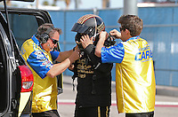Apr. 5, 2013; Las Vegas, NV, USA: NHRA crew members for funny car driver Tony Pedregon during qualifying for the Summitracing.com Nationals at the Strip at Las Vegas Motor Speedway. Mandatory Credit: Mark J. Rebilas-