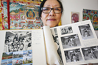 "Switzerland. Canton Thurgau. Littenheid. Dicki Shitsetsang at home with the photo album of her arrival on board a Swissair flight in Zürich-Kloten airport on march 16, 1964. The elderly swiss tibetan woman is an Aeschimann's child who arrived 50 years ago in Switzerland to receive custody on a private initiative by an influential Swiss industrialist, Charles Aeschimann. In 1962, Charles Aeschimann agreed with the Dalai Lama to take 200 children and place them in Swiss foster homes and give them a chance for a better life and a good education. Most of the children still had parents in exile or in Tibet, just a few were orphans. The 14th and current Dalai Lama is Tenzin Gyatso, recognized since 1950. He is the current Dalai Lama, as well as the longest-lived incumbent, well known for his lifelong advocacy for Tibetans inside and outside Tibet. Dalai Lamas are amongst the head monks of the Gelug school, the newest of the schools of Tibetan Buddhism. The Dalai Lama, also called "" Ocean of Wisdom"" is considered as the incarnation of Chenresi, the Bodhisattva of compassion who is also the protective deity of Tibet. 26.02.2015 © 2015 Didier Ruef"