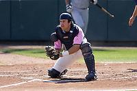 August 30, 2009: Everett AquaSox catcher Trevor Coleman blocks the plate during a Northwest League against the Salem-Keizer Volcanoes at Everett Memorial Stadium in Everett, Washington.  The AquaSox wore pink jerseys for breast cancer awareness.