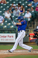 Round Rock Express outfielder Ryan Strausborger (6) swings the bat during the Pacific Coast League baseball game against the Omaha Storm Chasers on June 1, 2014 at the Dell Diamond in Round Rock, Texas. The Express defeated the Storm Chasers 11-4. (Andrew Woolley/Four Seam Images)