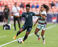 HOUSTON, TX - JUNE 13: Francisca Ordega #17 of Nigeria is defended by Jessica Silva #10 of Portugal during a game between Nigeria and Portugal at BBVA Stadium on June 13, 2021 in Houston, Texas.
