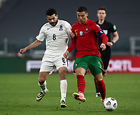 Footbal Soccer: FIFA World Cup Qatar 2022 Qualification, Portugal - Azerbaijan, Allianz Stadium , Turin, March 24, 2021.<br /> Portugal Cristiano Ronaldo (R) in action with Azerbaijan's Emin Makhmudov (L) during the FIFA World Cup Qatar 2022 qualification, football match between Portugal and Azerbaijan, at Allianz Stadium in Turin, on March 24, 2021.<br /> UPDATE IMAGES PRESS/Isabella Bonotto