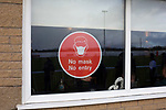Holker Old Boys 2 Crook Town 1, 10/10/2020. Rakesmoor, FA Vase second round qualifying. A face mask warning sign on the social club window pictured as Holker Old Boys take on Crook Town in an FA Vase second round qualifying tie at Rakesmoor, Barrow-in-Furness. The home club was established in 1936 as Holker Central Old Boys and was initially an under-16 team for former pupils of the Holker Central Secondary School. Holker from the North West Counties League beat their Northern League opponents 2-1, watched by a crowd of 147 spectators. Photo by Colin McPherson.