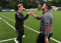 Head Coach Aline Zeler of Sporting Charleroi and Head Coach Tiziano Rutilo of Woluwe pictured during a female soccer game between Sporting Charleroi and White Star Woluwe on the first matchday in the 2021 - 2022 season of Belgian Scooore Womens Super League , friday 20 August 2021 in Marcinelle , Belgium . PHOTO SPORTPIX | DAVID CATRY