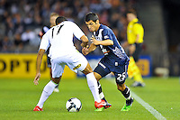 MELBOURNE, AUSTRALIA - FEBRUARY 5, 2010: Aziz Behich from Melbourne Victory contrlols the ball in round 26 of the A-league match between Melbourne Victory and North Queensland Fury at Etihad Stadium on February 5, 2010 in Melbourne, Australia. Photo Sydney Low www.syd-low.com