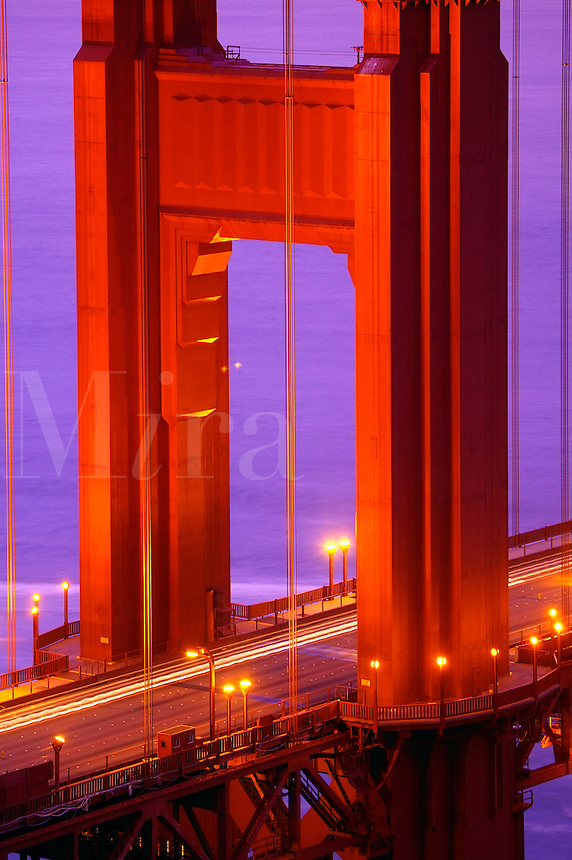 The streaks of lights from autos on the Golden Gate Bridge in the evening, San Francisco, California