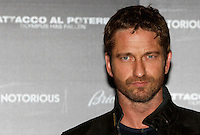 """L'attore scozzese Gerard Butler posa durante il photocall del film """"Attacco al potere"""" a Roma, 5 aprile 2013..British actor Gerard Butler poses during the photocall of the movie """"Olympus has fallen"""" in Rome, 5 April 2013..UPDATE IMAGES PRESS/Isabella Bonotto."""