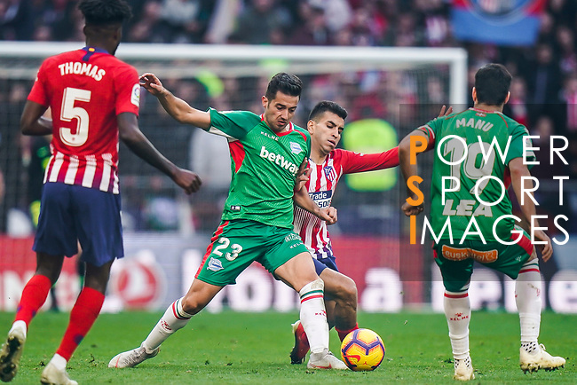 Jonathan Rodriguez Menendez, Jony, of Deportivo Alaves fights for the ball with Angel Correa of Atletico de Madrid during the La Liga 2018-19 match between Atletico de Madrid and Deportivo Alaves at Wanda Metropolitano on December 08 2018 in Madrid, Spain. Photo by Diego Souto / Power Sport Images