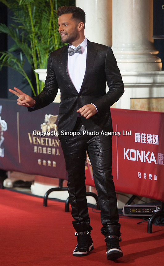 Puerta Rican singer Ricky Martin is seen on the red carpet at the 18th Channel [V] China Music Awards and Asian Influential Power Grand Ceremony at the Venetian Macau Casino in Macau, China, 23 April 2014