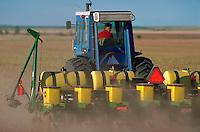 Farmer planting corn field.