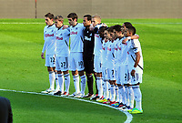 NO BYLINE PLEASE<br /> Pictured: Swansea players observe a minute's silence  before kick off in memory of Wales football manager Gary Speed who has died. Sunday 27 November 2011<br /> Re: Premier League football Swansea City FC v Aston Villa at the Liberty Stadium, south Wales.