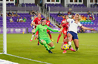 ORLANDO CITY, FL - FEBRUARY 18: Stephanie Labbé #1 of Canada battles with Lindsey Horan #9 of the United States in the box during a game between Canada and USWNT at Exploria Stadium on February 18, 2021 in Orlando City, Florida.