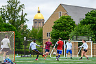 May 28, 2021; Graduate students, faculty and staff play a lunchtime soccer match near Stepan Center. They say the informal matches have been taking place since the 1970s. (Photo by Matt Cashore/University of Notre Dame)