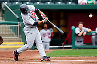 Luis Jimenez (7) of the Arkansas Travelers smashes a pitch during a game against the Springfield Cardinals on May 10, 2011 at Hammons Field in Springfield, Missouri.  Photo By David Welker/Four Seam Images.