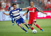 FC Dallas midfielder Ricardo Villar #11 and Toronto FC defender Mikael Yourassowsky #19 in action during an MLS game between the FC Dallas and the Toronto FC at BMO Field in Toronto on July 20, 2011..FC Dallas won 1-0.