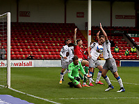 10th October 2020; Bescot Stadium, Walsall, West Midlands, England; English Football League Two, Walsall FC versus Colchester United; Walsall players appeal for hand ball against Tommy Smith of Colchester United