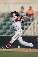 Austin Rei (13) of the Greenville Drive follows through on his swing against the Kannapolis Intimidators at Intimidators Stadium on June 7, 2016 in Kannapolis, North Carolina.  The Drive defeated the Intimidators 4-1 in game one of a double header.  (Brian Westerholt/Four Seam Images)