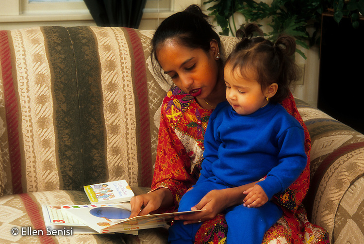 MR / Schenectady, NY. Mother (Asian Indian-American) reads to her daughter (18 months, Asian Indian-American & Caucasian). This image has been digitally altered. MR: Kos2, Kos3. © Ellen B. Senisi