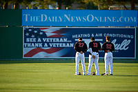 Batavia Muckdogs outfielders Troy Johnston (27), Albert Guaimaro (13), and J.D. Orr (22) during the national anthem before a NY-Penn League game against the Auburn Doubledays on August 31, 2019 at Dwyer Stadium in Batavia, New York.  Auburn defeated Batavia 12-5.  (Mike Janes/Four Seam Images)