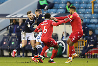 both Nottingham Forest players and Millwall players collide into each other during Millwall vs Nottingham Forest, Sky Bet EFL Championship Football at The Den on 19th December 2020