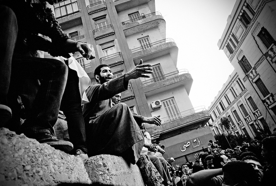 Egyptian protestors argue amongst themselves at a newly built barbed wire and concrete barrier near Tahrir Square, Cairo, Egypt, Thursday, Nov. 24, 2011. After five consecutive days of violent clashes between protestors and security forces in Cairo, both sides seem to be observing a tenuous truce on Thursday morning.