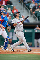 Scranton/Wilkes-Barre RailRiders first baseman Mike Ford (25) follows through on a swing in front of catcher Danny Jansen (9) during a game against the Buffalo Bisons on May 18, 2018 at Coca-Cola Field in Buffalo, New York.  Buffalo defeated Scranton 5-1.  (Mike Janes/Four Seam Images)
