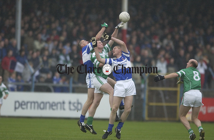 Kilrush's john Moody is caught between the Kilkee might of the Russell brothers Denis and  David during the county final in Cusack Park. Photograph by John Kelly