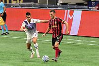 ATLANTA, GA - AUGUST 29: Brooks Lennon #11 of Atlanta United passes the ball during a game between Orlando City SC and Atlanta United FC at Marecedes-Benz Stadium on August 29, 2020 in Atlanta, Georgia.