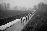 Dwars Door Vlaanderen 2013.peloton over muddy Ladeuze descent