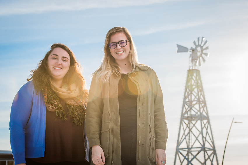 UAA Journalism students Victoria Petersen, left, and Samantha Davenport, right, photographed by the Windmill in Spenard. Peterson is the founder and editor-in-chief of The Spenardian, a hyper-local news source for Anchorage's Spenard neighborhood. Davenport is the Spenardian's Managing Editor.