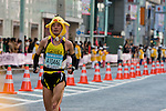 Feb. 27, 2010 - Tokyo, Japan - A runner wearing a cute head costume races through the Ginza district part of town during the Tokyo Marathon. Some 36,000 runners participated in this fifth edition of the Tokyo Marathon.