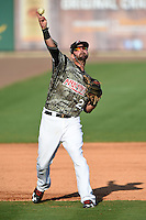 Arkansas Travelers third baseman Kaleb Cowart (21) warmup throw to first during a game against the San Antonio Missions on May 25, 2014 at Dickey-Stephens Park in Little Rock, Arkansas.  Arkansas defeated San Antonio 3-1.  (Mike Janes/Four Seam Images)