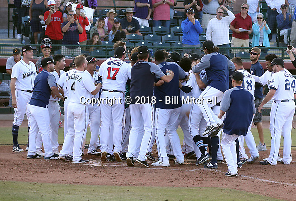 The Peoria Javelinas celebrates after winning the 2018 Arizona Fall League championship game, 3-2 in 10 innings, over the Salt River Rafters at Scottsdale Stadium on November 17, 2018 in Scottsdale, Arizona (Bill Mitchell)
