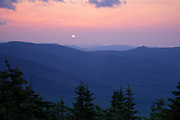 Sunrise over mountains during the summer months from the summit of Mount Tecumseh in Waterville Valley, New Hampshire. Named for the Shawnee war chief Tecumseh (1768–1813), this mountain is a popular day hike.