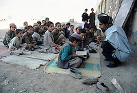 A new school build by the Taleban government, finance by the Saudis, in Jalez village. Talebans teach the Koran, grammar, mathematics, geography, and civility. The school is still to small to received all the childrens from around the valley that they have to class outside.