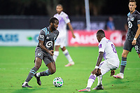 LAKE BUENA VISTA, FL - AUGUST 06: Kevin Molino #7 of Minnesota United FC dribbles the ball during a game between Orlando City SC and Minnesota United FC at ESPN Wide World of Sports on August 06, 2020 in Lake Buena Vista, Florida.