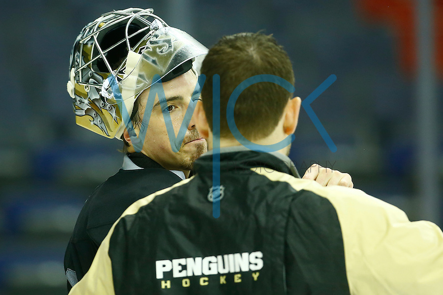 Marc-Andre Fleury #29 of the Pittsburgh Penguins talks with goaltending coach Mike Bales during the morning skate at the Verizon Center in Washington D.C. on April 28, 2016. (Photo by Jared Wickerham / DKPS)