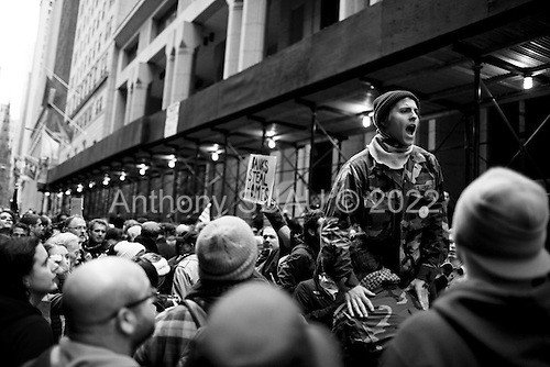 """New York, New York<br /> November 17, 2011<br /> <br /> """"Occupy Wall Street"""" protesters mark the movement's two-month milestone by marching from Zuccotti Park, in mass, to various access streets surrounding the New York Stock Exchange, which the police had barricaded off. Yet instead of the police keeping protesters out, protesters locked down those entrances to Wall Street and the New York Stock Exchange creating havoc as the police made more then 240 arrests to try and keep the streets open to normal traffic.<br /> <br /> Protesters move around the streets to block Wall Street employees from work and disrupt business as usual while chanting against financial inequality."""
