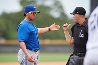 GCL Blue Jays manager Luis Hurtado (31) talks with home plate umpire Steven Jaschinski during the second game of a doubleheader against the GCL Yankees East on July 24, 2017 at the Yankees Minor League Complex in Tampa, Florida.  GCL Yankees East defeated the GCL Blue Jays 6-3.  (Mike Janes/Four Seam Images)