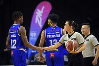 Umpire Aimee-Jo Clark shakes Kerwin Roach's hand before the National Basketball League match between the Wellington Saints and Manawatu Jets at TSB Bank Arena in Wellington, New Zealand on Sunday, 13 June 2021. Photo: Dave Lintott / lintottphoto.co.nz