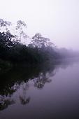 A-Ukre village, Brazil. Misty dawn on a tropical river; Xingu River, Para State.