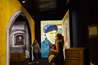 """LISBON, PORTUGAL - MAY 31: Visitors wearing face masks attends the """"Meet VicentVanGogh"""" exhibition as the spread of the (COVID-19) continues in Lisbon, on May 31, 2020. <br /> Meet Vincent van Gogh is an interactive experience, to get to know Lisbon, through which it proposes to make Vincent's art accessible to as many people as possible.<br /> (Photo by Luis Boza/VIEWpress via Getty Images)"""