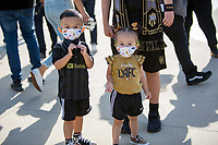 LOS ANGELES, CA - APRIL 17: Young LAFC supporters during a game between Austin FC and Los Angeles FC at Banc of California Stadium on April 17, 2021 in Los Angeles, California.