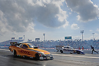 Apr. 27, 2012; Baytown, TX, USA: NHRA funny car driver Jeff Arend (near lane) alongside Matt Hagan during qualifying for the Spring Nationals at Royal Purple Raceway. Mandatory Credit: Mark J. Rebilas-