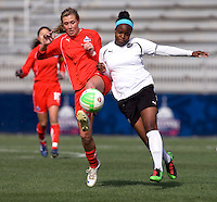 Allie Long of the Washington Freedom fights collides with Danesha Adams of the Philadelphia Independence during their preseason game at the Maryland SoccerPlex in Germantown, Maryland.