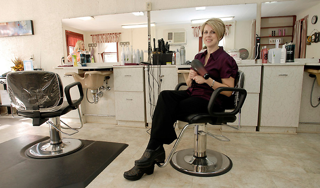 Owner of the Simply Hair Salon, Tonia Brickner waits foir her next customer Thursday, Oct. 28, 2010 in CArlisle, Pa. (Bradley C Bower/KeyStoneEdge)